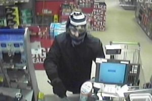 police issue cctv of wanted shanklin co op armed robber