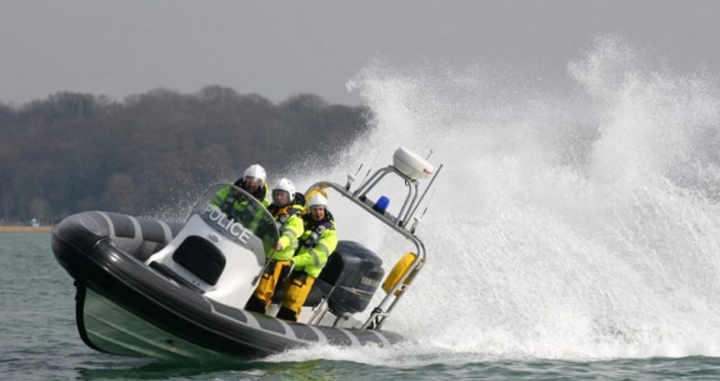 Police  Searching For Missing  Black Hulled Boat