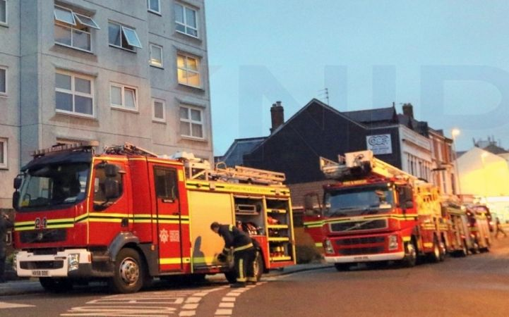 fire engine take patient to hospital after tower block fire in portsmouth