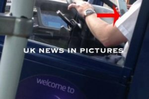 eclipse bus driver snapped using mobile phone whilst driving bus