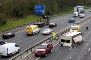 fairground lorry overturns on m27