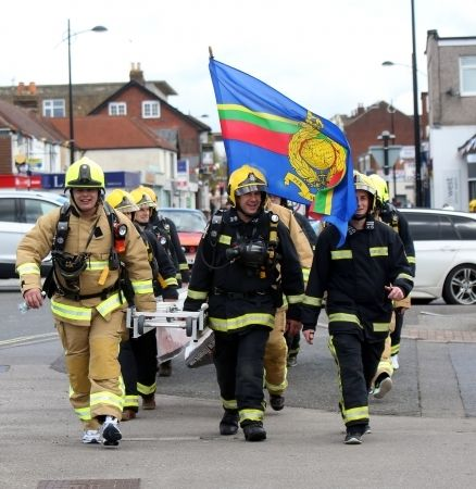 thirty ladder laden firefighter raise money for the firefighters charity