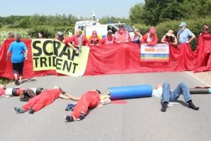 anti nuclear protesters chain themselves together outside weapons establishment