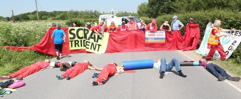 Anti-nuclear Protesters Chain Themselves Together Outside Weapons Establishment