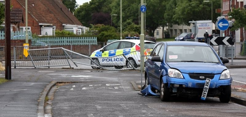 car mounts roundabout hits railing and lands in garden in gosport