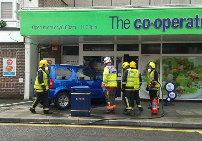 lucky escape for shoppers after car careers into co op