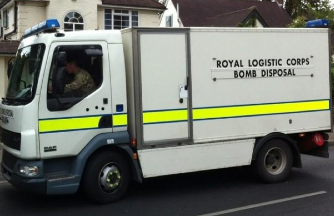man arrested on suspicion of possession of an explosive after street evacuated