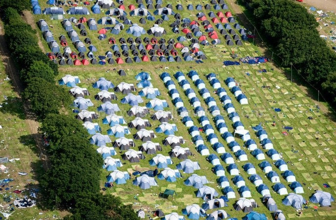 police have arrested four men following thefts from tents at the isle of wight festival
