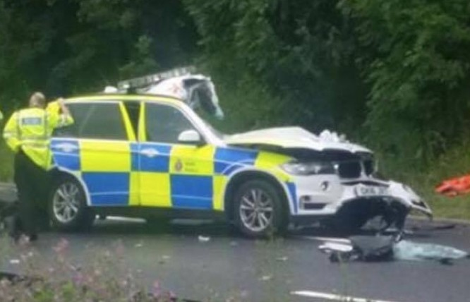 police officers taken to hospital after collision with lorry