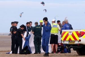 mans body recovered from beach after being swept out to sea with two other men left fighting for their lives