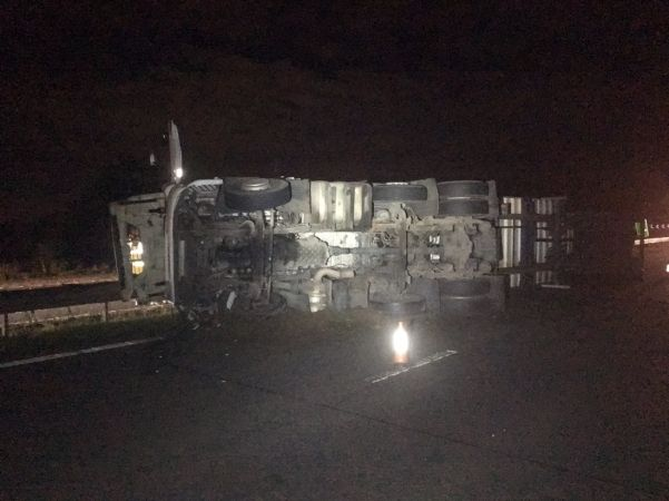 major road closed after overturned lorry near ower