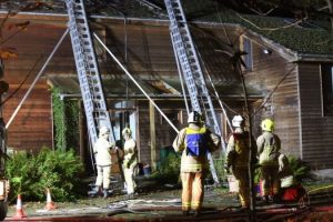 fire crews battle to save surrey property after roof fire
