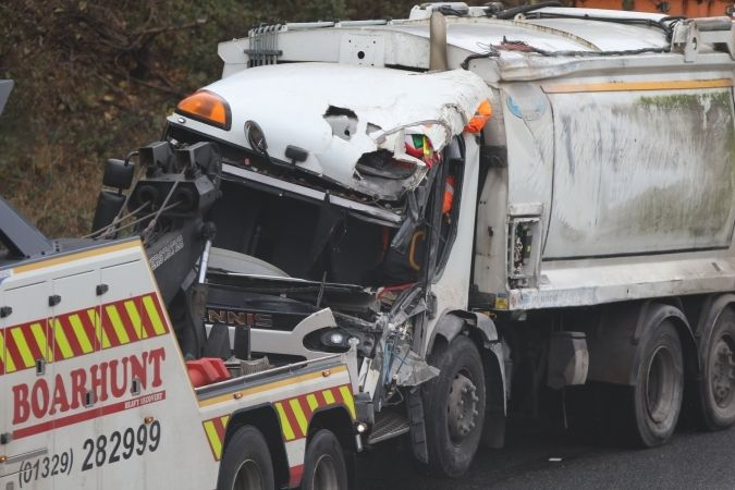 three injured after dustcart blown over by freak wind gust on m27