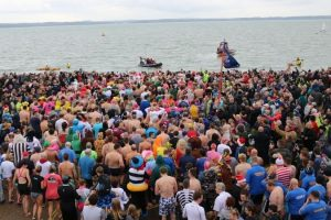 five hundred take chilly swim in the solent to raise much needed funds for independent lifeboat station
