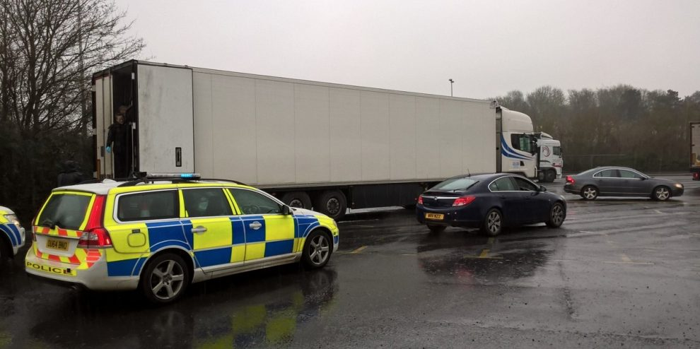 11 refugees found in trailer on m40 after hand spotted waving at passing motorist