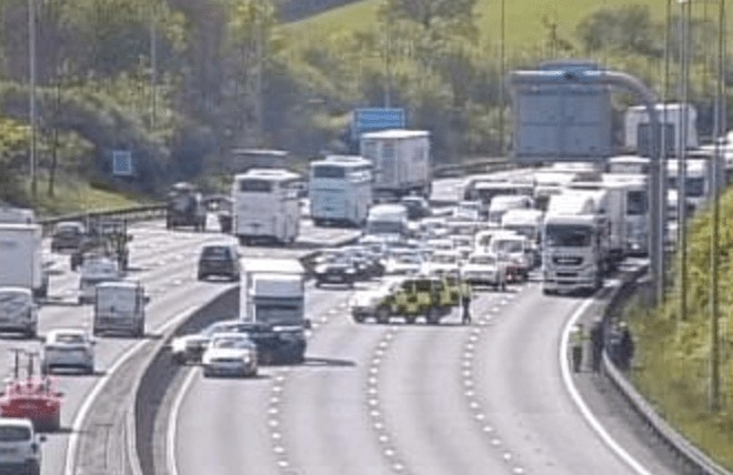 a collision involving a truck and a car has closed 2 lanes of the m25 motorway