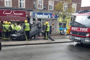 fire crews battle to free driver trapped in overturned car twickenham