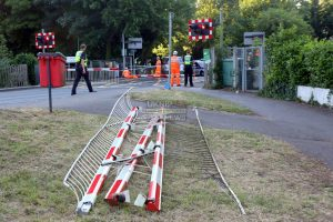 impatient car driver caused thousand of pounds of damage after driving through railway level crossing barriers in egham