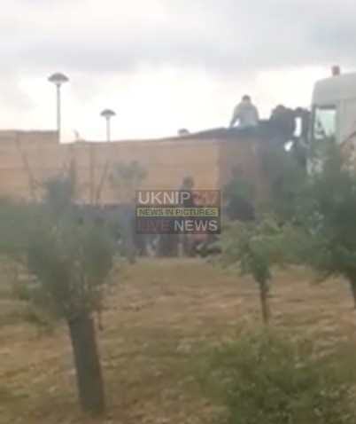 shocking moment a gang of up to 40 suspected illegal migrants climb out of a french lorry parked up at an m25 service station