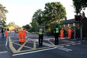 woman attacked at burger king and vehicle than drives through train level crossing in egham