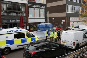 man crushed to death by shop roller shutter in woking
