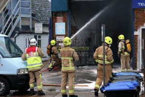 fire rips through car workshop in byfleet after vans fuel line explodes