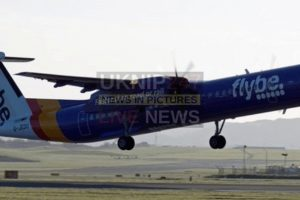 flybe flight carries out emergency landing with nose gear up on runway in belfast