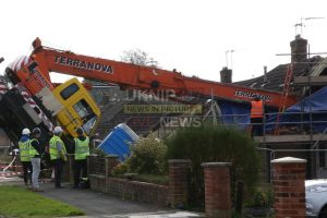 help i need a lift mobile crane crushes a bungalow after the 27 tonne machine tips over sending its telescopic boom crashing through the buildings roof