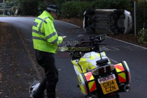 woman rushed to hospital after car overturns in rudgwick