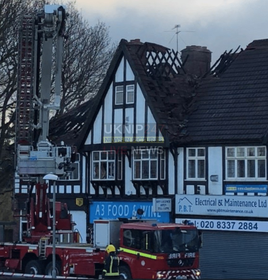 two dead after fire rips through flat above a shop in south west london