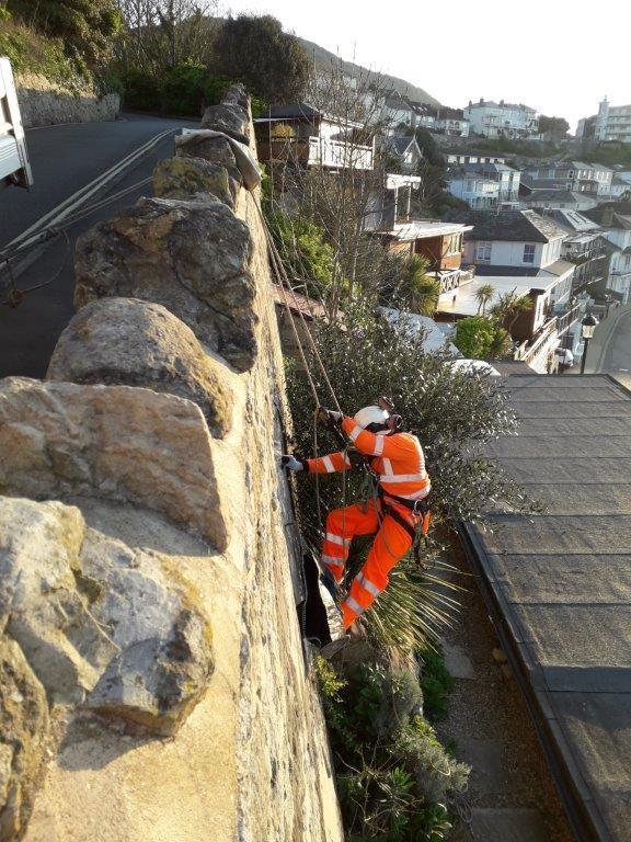 specialist on ropes called in to help island roads maintain structures