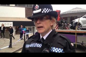 surrey police speaking at the scene after seven people hurt outside guildford shopping centre