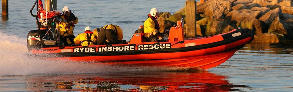 two people rescued by coastguard after being cut off by tide