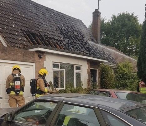 92 year old pensioner pulled from house a blaze by fire fighters
