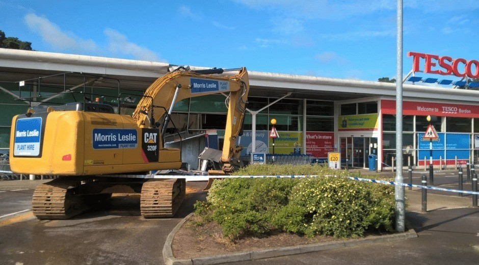 cheeky thieves use digger to rob cashpoint from bordon tesco