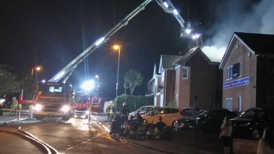fire rips through park gate block of flats and spreads to roof