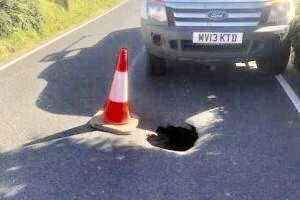 sinkhole not to be confused with pothole appears on isle of wight road