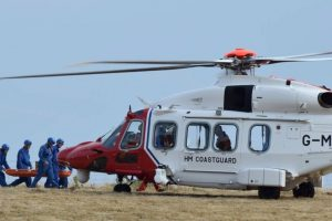 coastguard helicopter called after woman has an allergic reaction and collapses at bottom of cliffs in the west wight