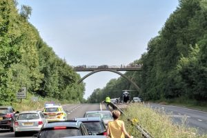 police closed a21 in kent in both directions after a woman has fallen from a bridge
