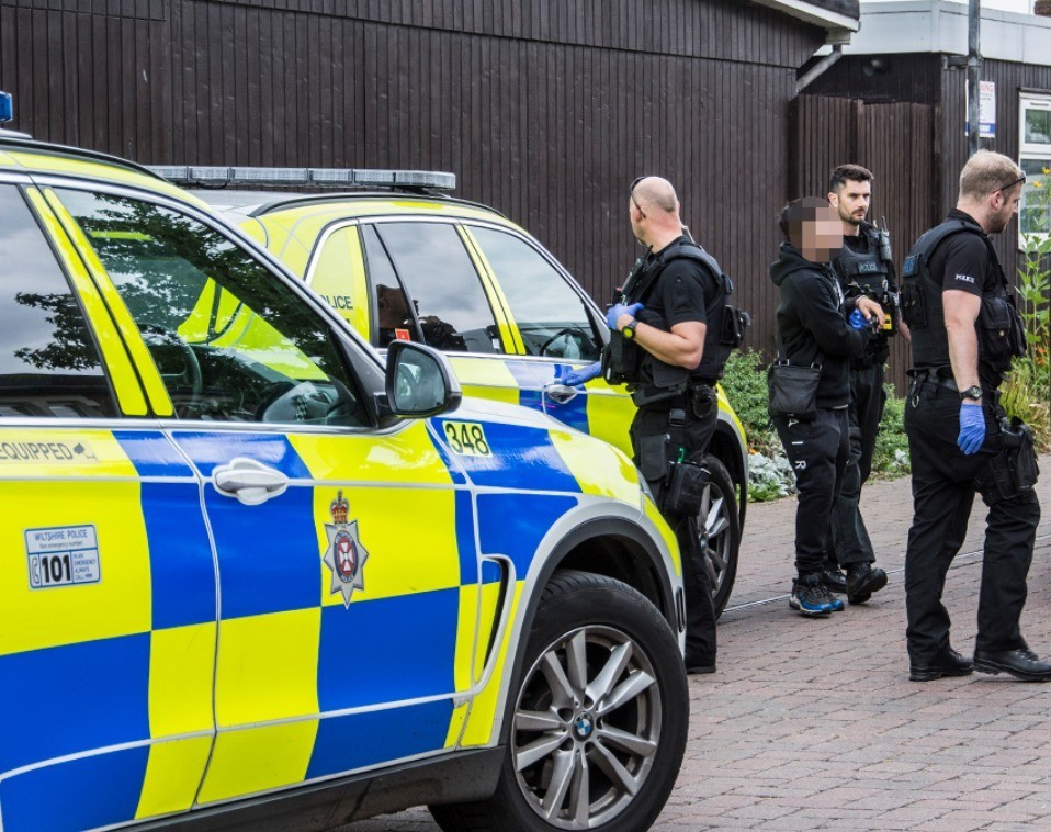 shakedown in swindon as armed officers swarm street and make arrests