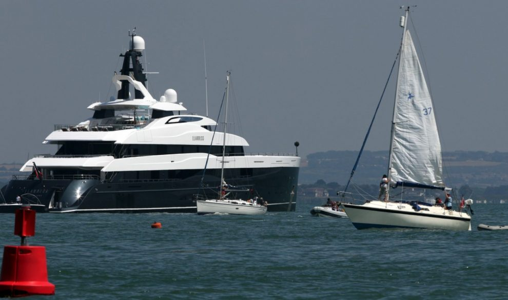 super rich travelex business man moors up floating palace at the entrance to cowes