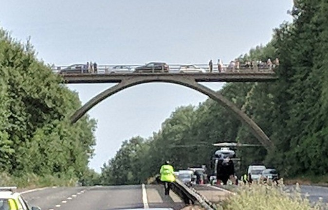 woman has died after plunging from a road bridge in sevenoaks