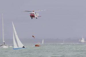 cowes week sailor rushed to hospital after falling overboard
