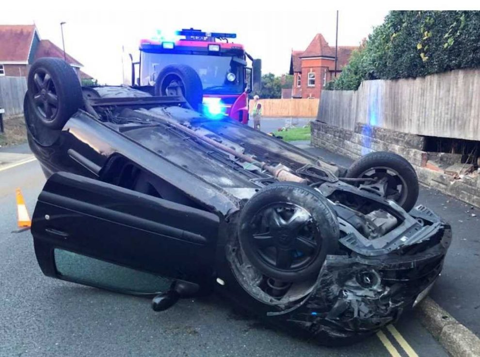 driver escapes serious injury after car hits wall and flips