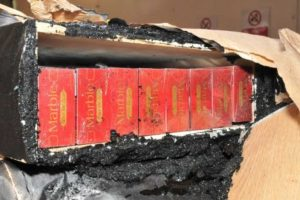 three men have been jailed after they were caught with more than 1 5 million illegal cigarettes