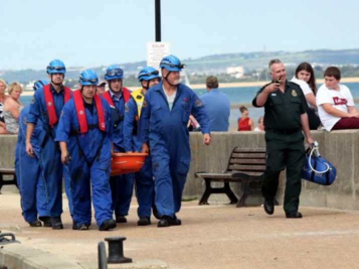 two boys and a carer from local home rescued from mud in ryde