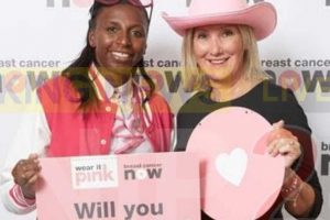 caroline dinenage added a splash of pink to her usual attire to support breast cancer nows wear it pink fundraiser