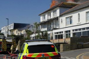 fire crews to remain overnight following sandown hotel fire
