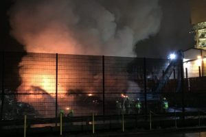 fire crews battle scrapyard fire