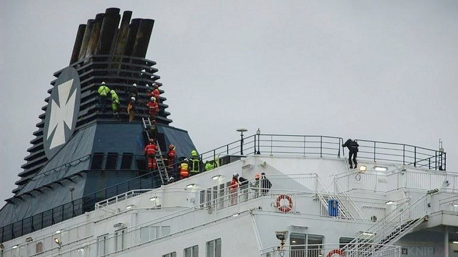 forty migrants arrested who climbed aboard a ferry